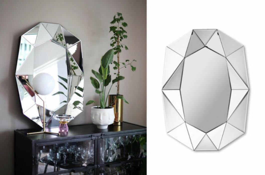 Diamond spegel, fin inredning med spegel på skåp med lampa från Flos och mässingskruka.