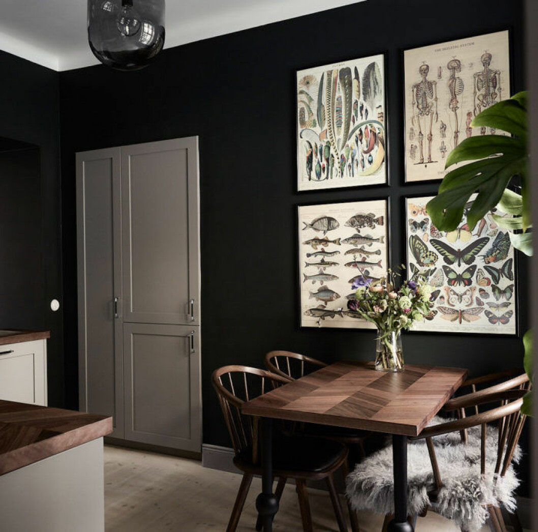 Scandinavian decoration and ideas. Black painted walls and art wall in kitchen.