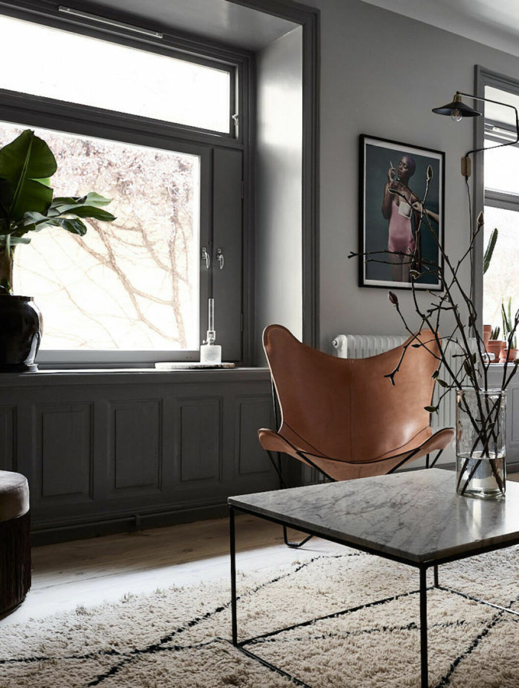 Scandinavian decoration and ideas. Design chair and marble sofa table. Grey walls.