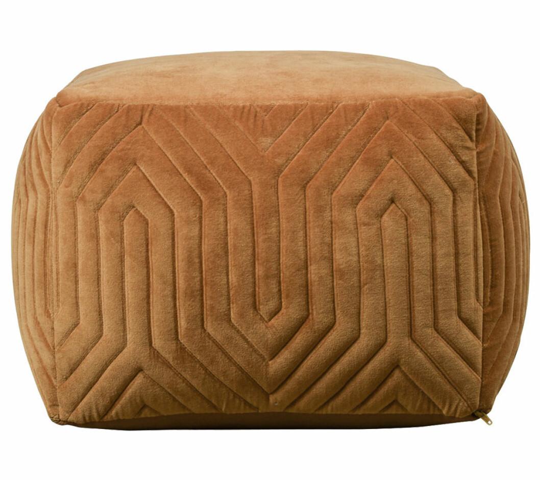 Gul sittpuff med strukturerad yta i sammet.