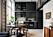 Stilrent svart platsbyggt kök och matplats i samma färg