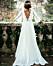 Brudklänning med vida armar och öppen rygg