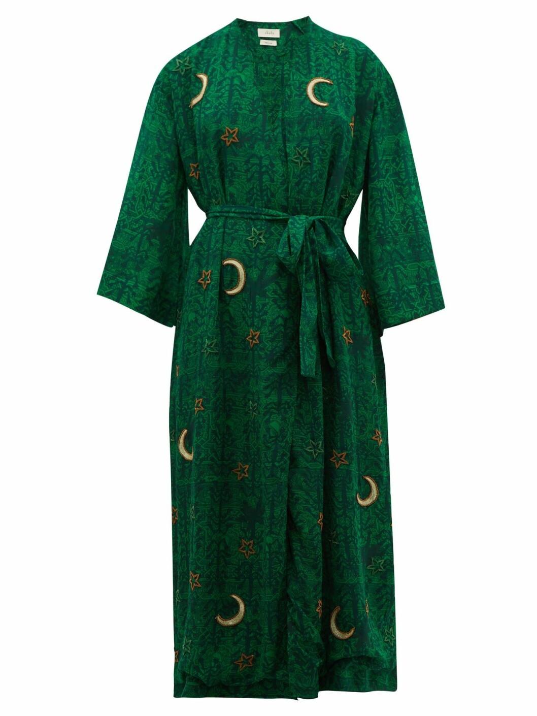 Mörkgrön elegant kaftan/morgonrock med astroinspirerade motiv av stjärnor och månar.