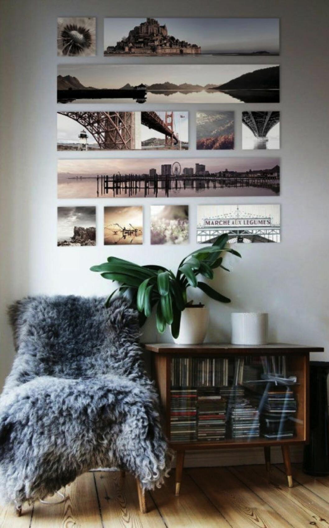 Framkallade bilder i olika storlekar skapar en dekorativ tavelvägg