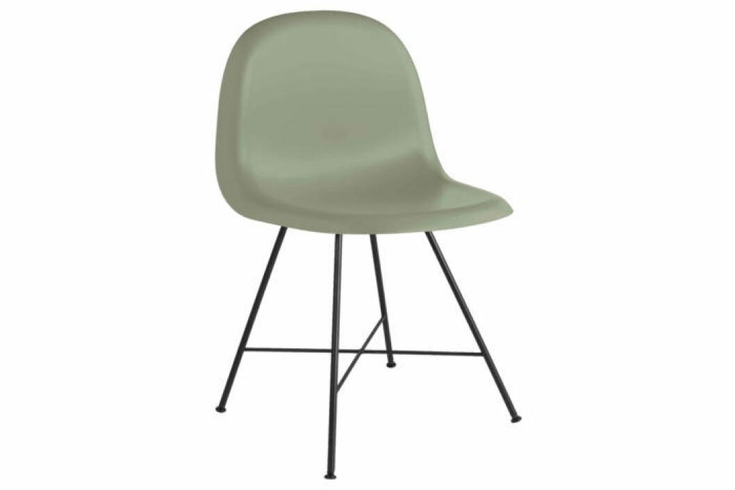 Ljusgrön stol med svartlackerade metallbe