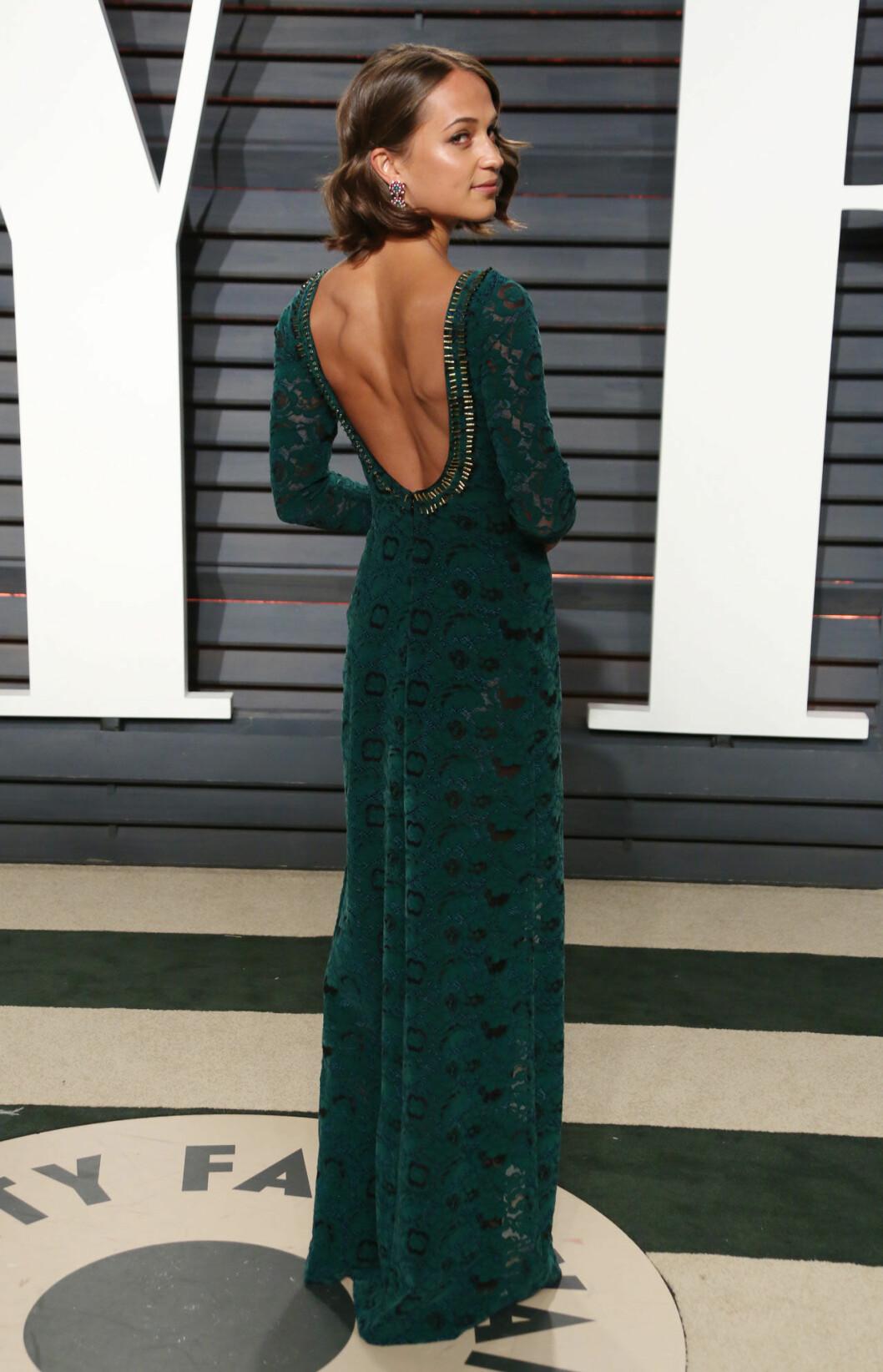 Alicia Vikander i en vacker grön klänning