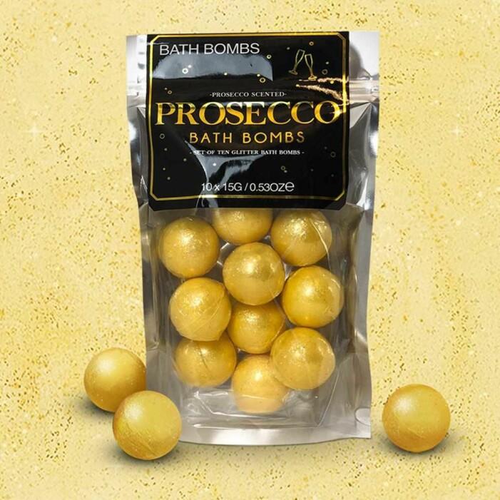 guldiga badbomber som doftar prosecco ligger i en påse