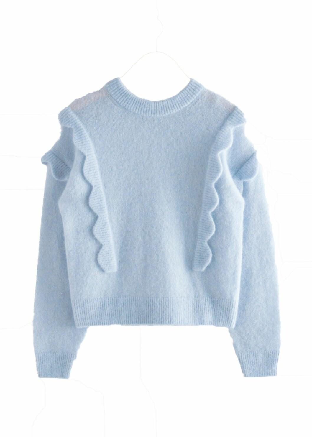 Stickad ljusblå tröja med söta volangdetaljer från & other stories