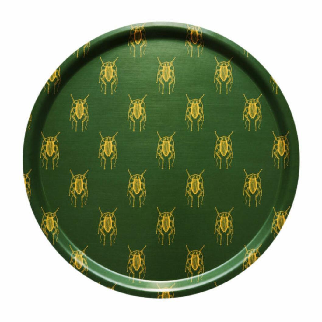 Grön bricka med gult mönster
