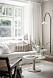 Snyggt inrett vardagsrum med färger med sommarkänsla