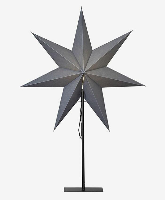 grå stjärna på fot från star trading