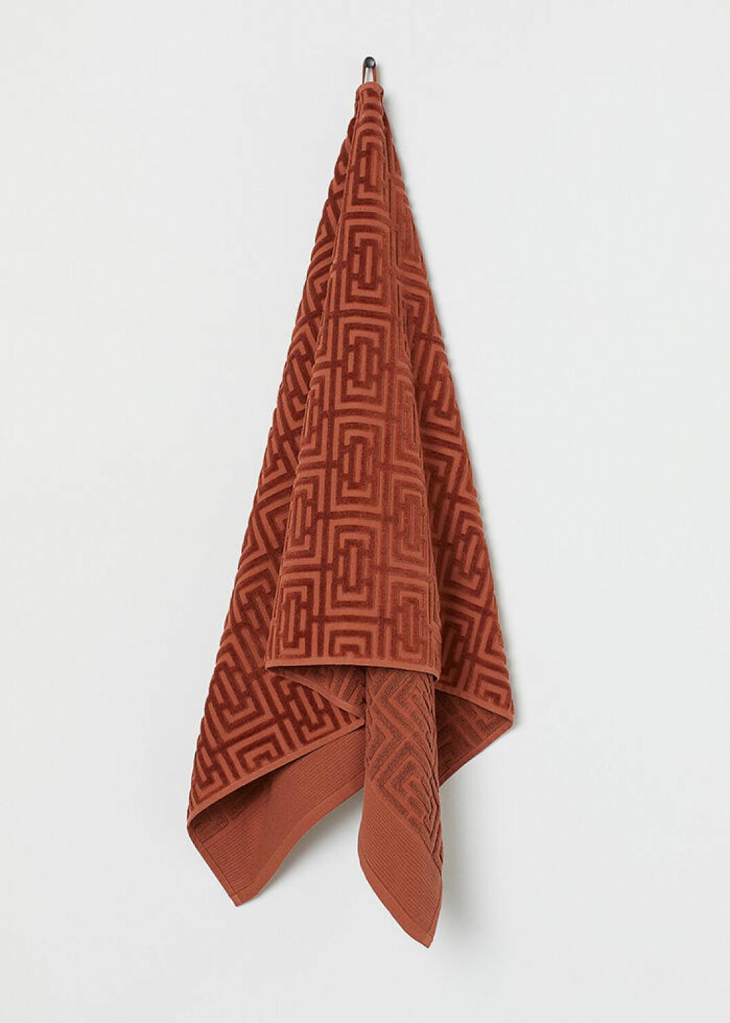 Jacquardmönstrad handduk i orange från H&M Home