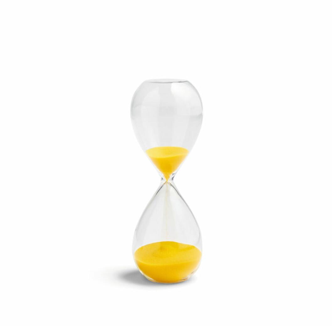 Hay timglas med gul sand