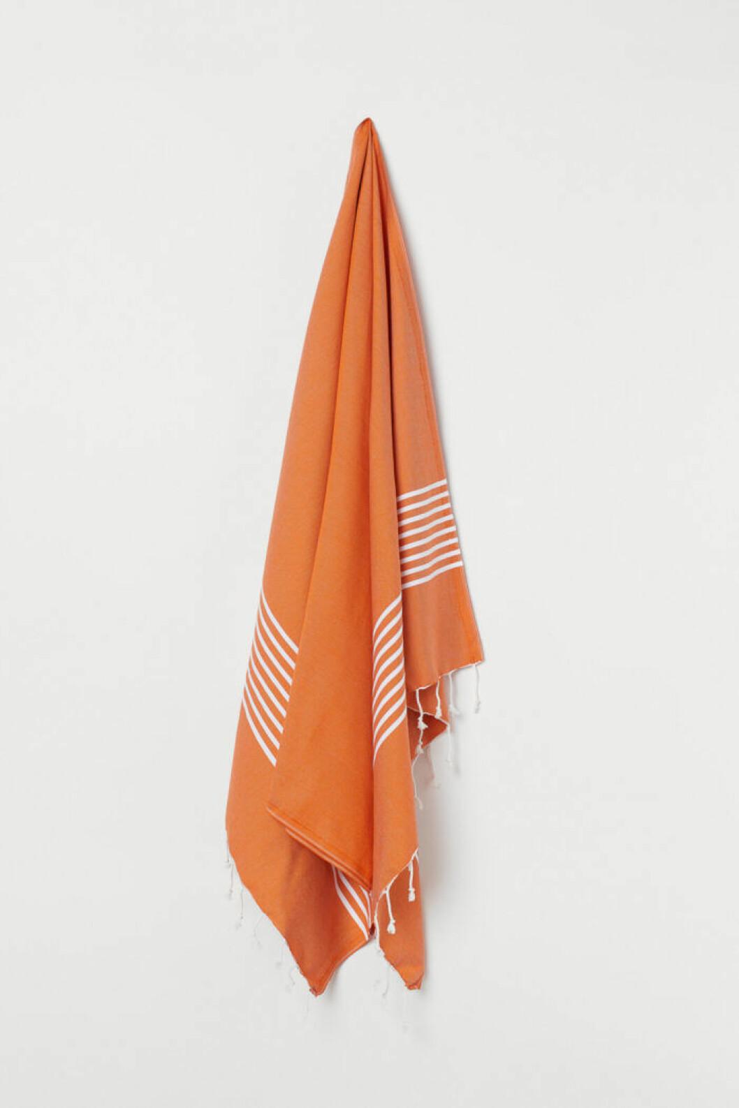 Bomullsfilt i orange från H&M Home.