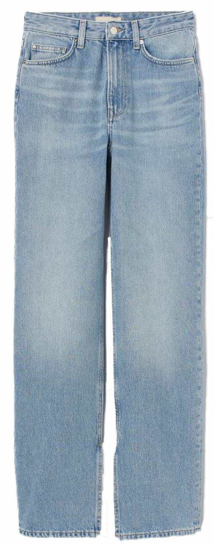 Jeans i rak modell från HM med dekorativ slits vid byxbenen .