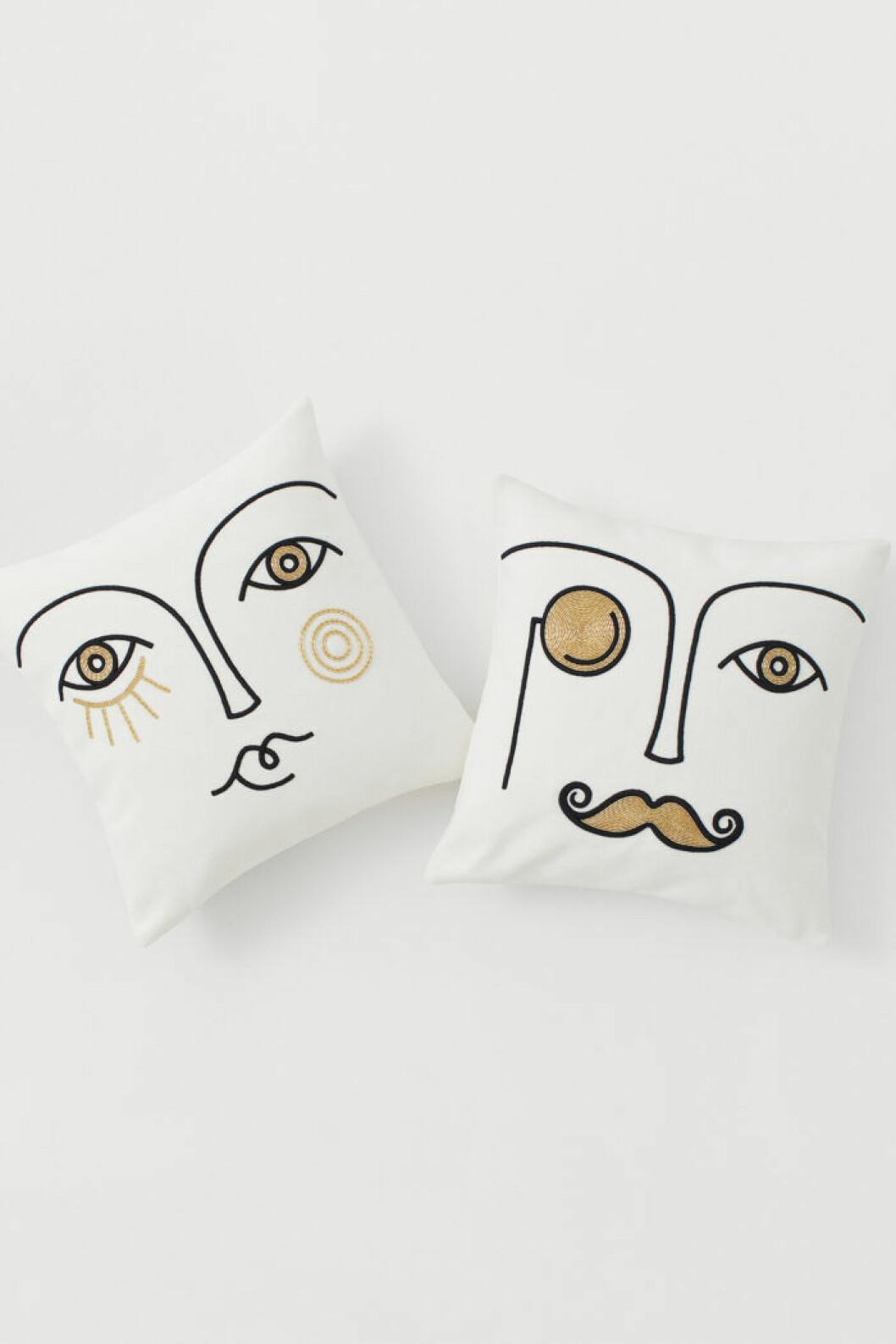 Vita kuddar med ansikten från Jonathan Adler x H&M