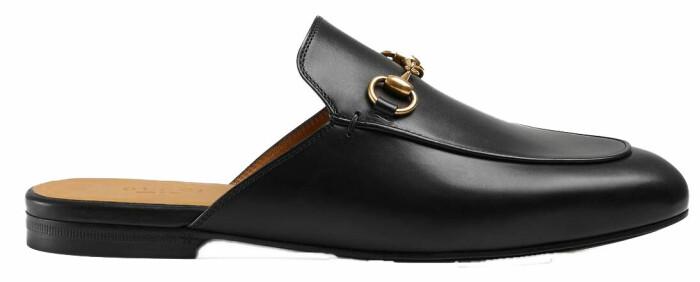 Klassiska slip-in sandaler från Gucci i svart.