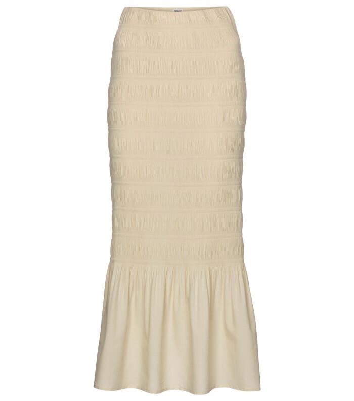 Krämvit kjol i smickrande figurnära modell med plisserade drag och en dekorativ volang nedtill.