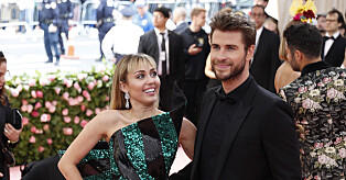 epa07552536 Miley Cyrus and Liam Hemsworth arrive on the red carpet for the 2019 Met Gala, the annual benefit for the Metropolitan Museum of Art's Costume Institute, in New York, New York, USA, 06 May 2019. The event coincides with the Met Costume Institute's new spring 2019 exhibition, 'Camp: Notes on Fashion', which runs from 09 May until 08 September 2019.  EPA/JUSTIN LANE