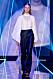 Vit blus och mörka byxor från visningen av årets nykomling Amanda Borgfors Mészáros.