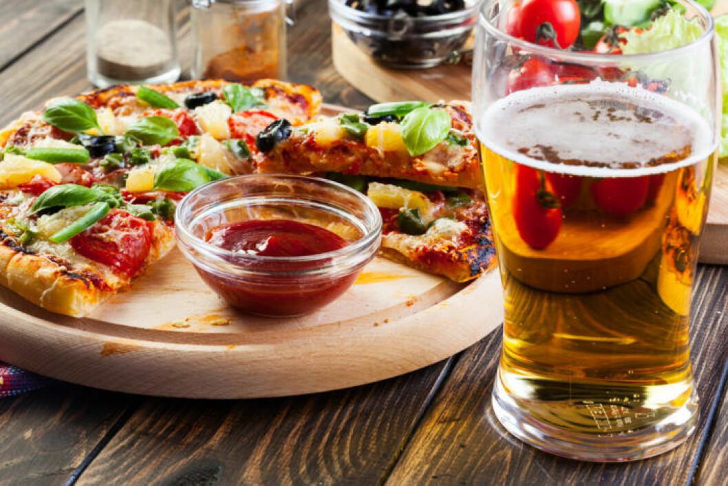Pizza och öl är en klassisk kombination. Foto: Shutterstock