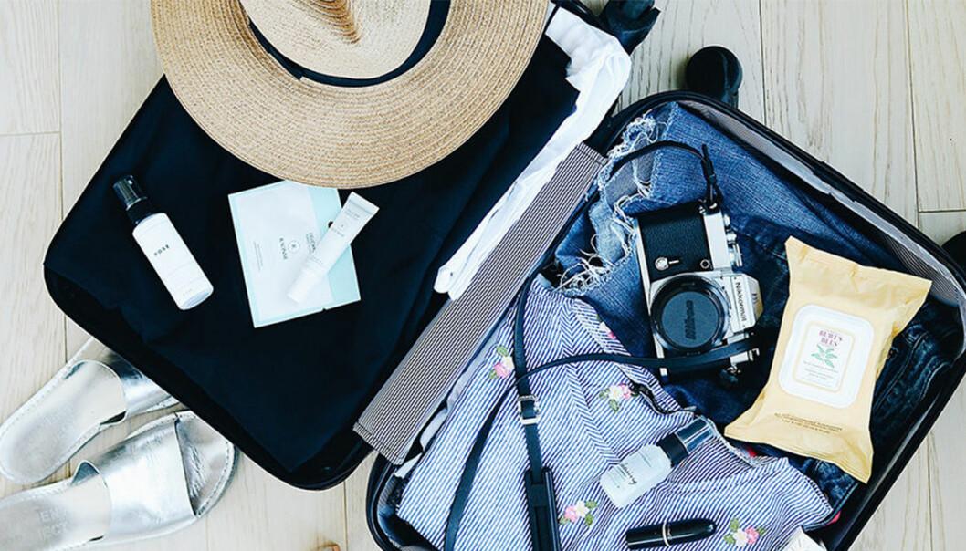 resväska fylls inför en resa