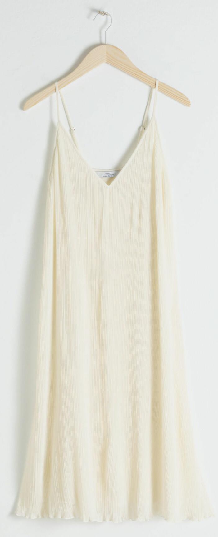 Plisserad klänning från & Other stories.