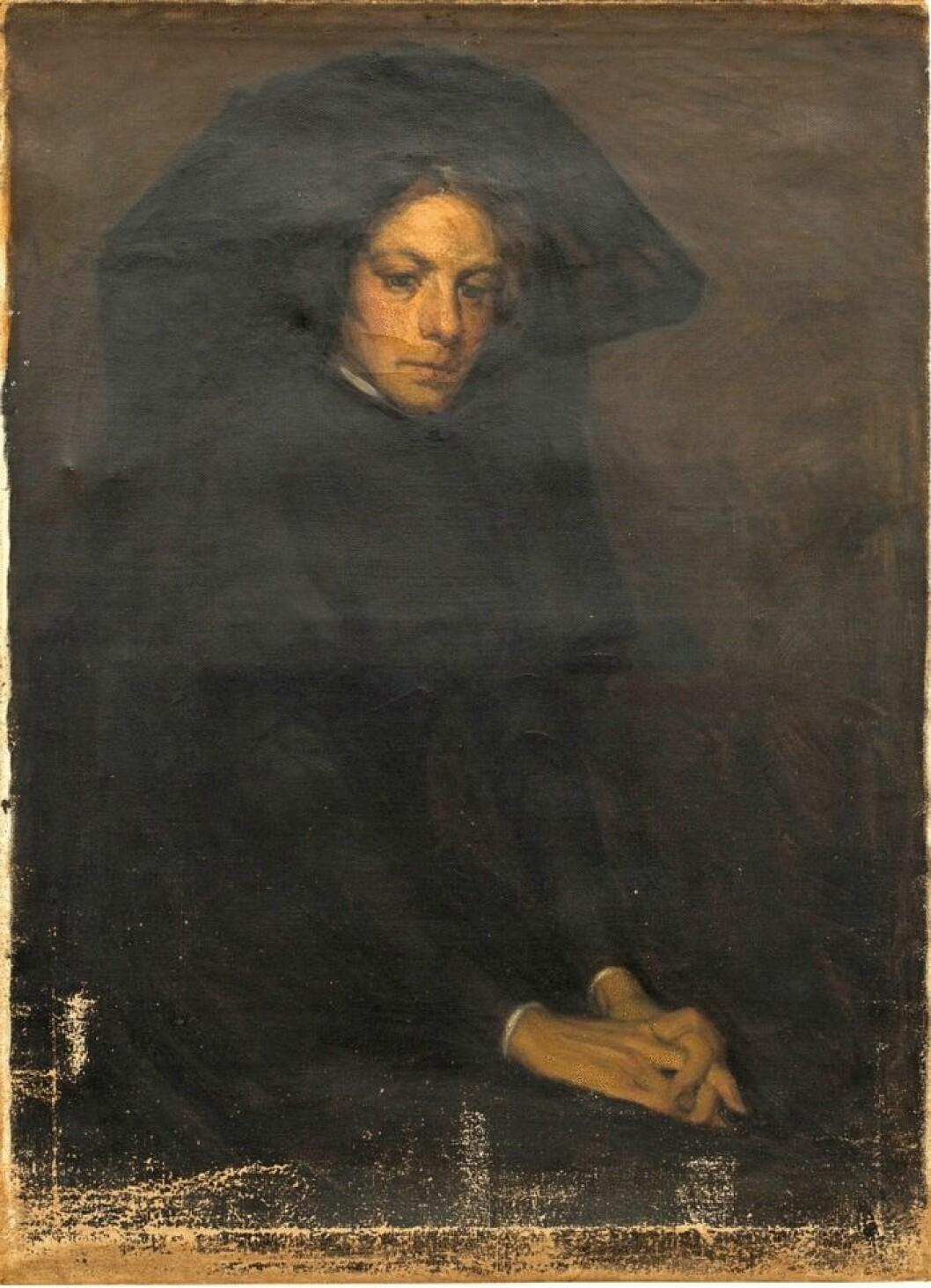 I sorg – porträtt av dam i svart