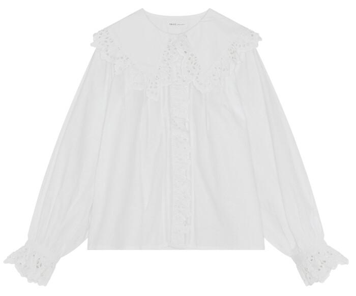 Feminin skjortblus från danska Skall studio med vackert dekorativ krage och ärmslut.