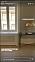 Ett stort sekelskiftesfönster och en lampa från Plain Vanilla.