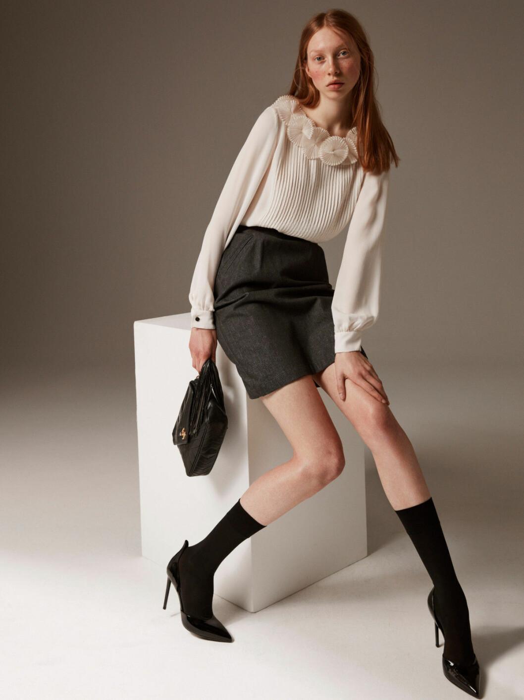 Blus, kjol och väska från Stockhoms Aktionsverk