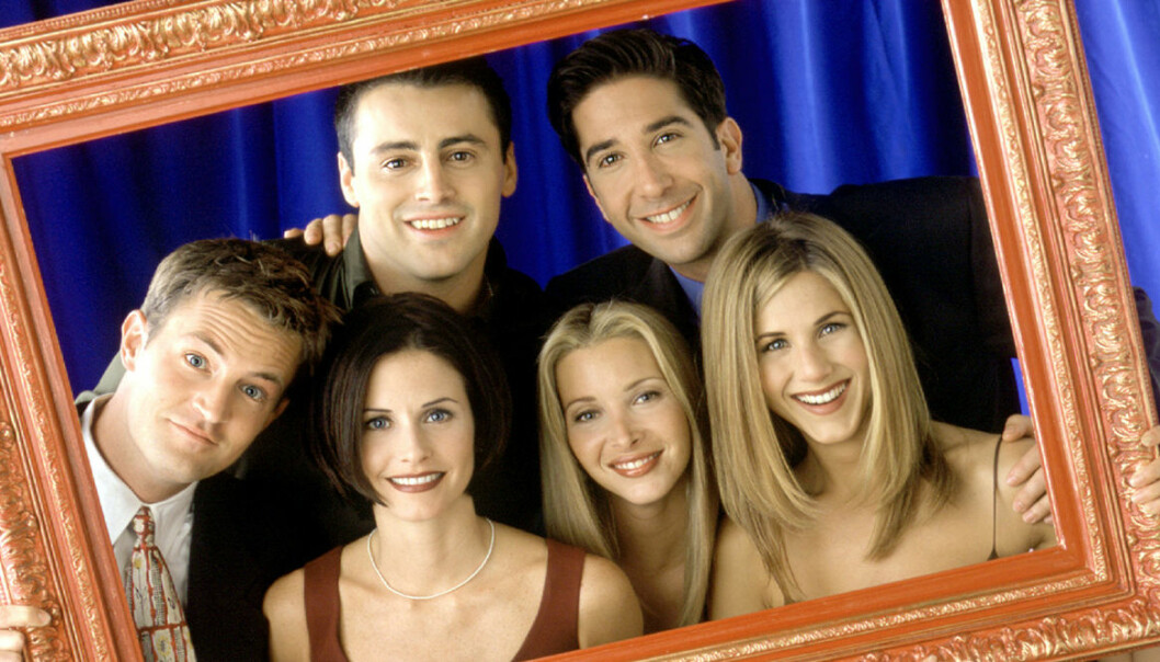 skådespelarna från Vänner kikar fram ur en tavelram