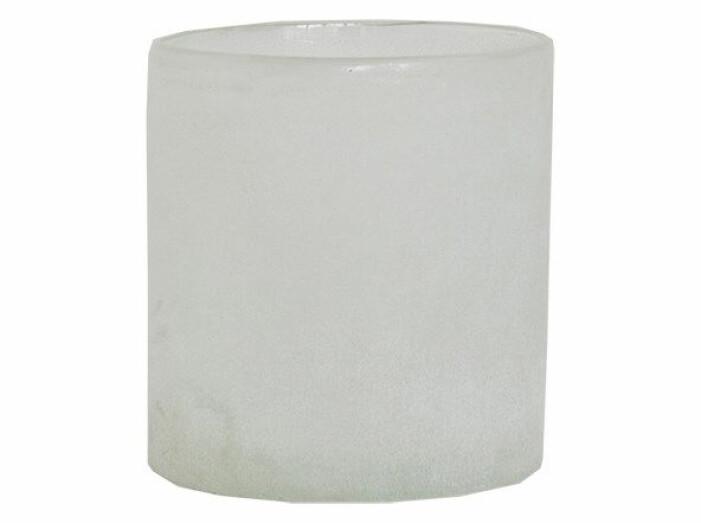 vit ljuslykta i glas