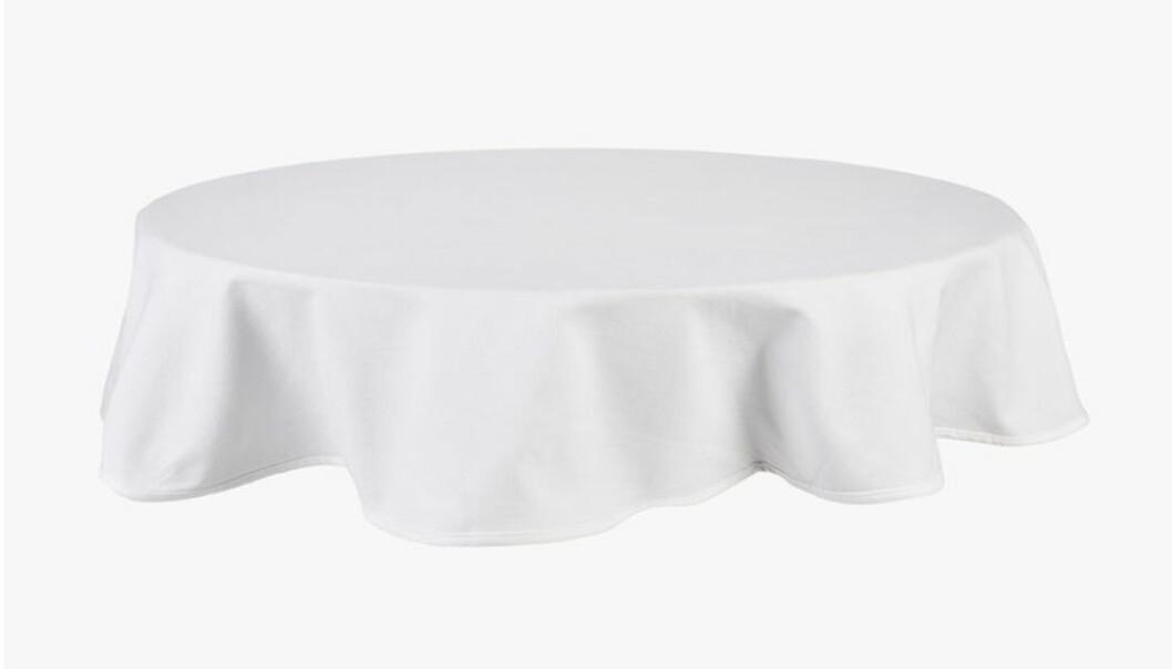 vit rund duk till runt bord